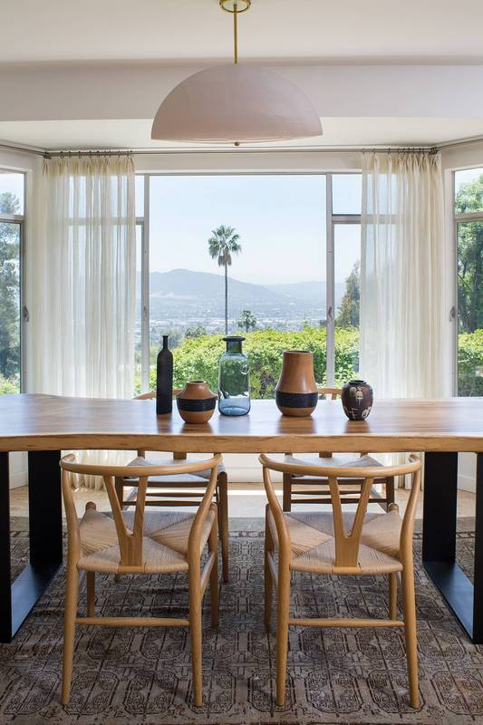 exclusive-home-tour-mid-century-goals-mid-century-modern-design-dining-room-with-window-582cb064eeb90a08340c6301-w620_h800